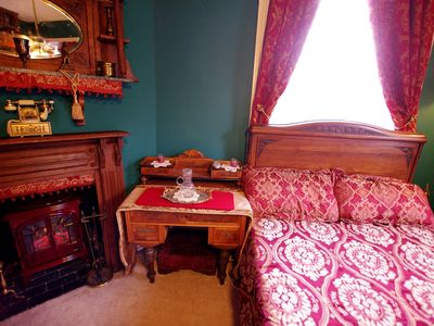 New Orleans house rental - Many beds are antique woods with hanging draperies and Victorian pillows!