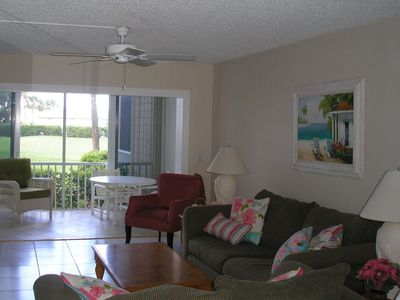 Living room with glassed-in porch - just walk out to the pool!