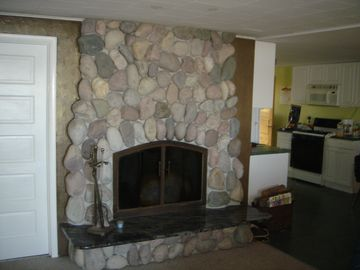 fieldstone fireplace in living room