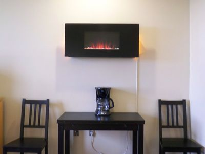 Enjoy the only fireplace in the building while you dine or recline!