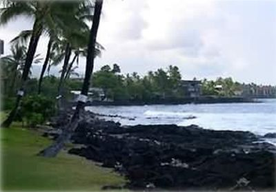Kailua Kona condo rental - View south from the grassy area in front of the Kona Reef. Surfers daily!