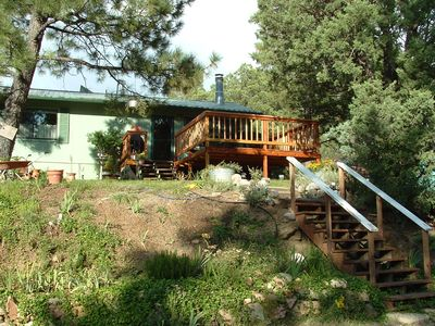 Front yard with a huge deck viewing Sierra Blanca and toward downtown Ruidoso