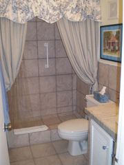 St. Croix condo photo - One of Three Bathrooms, all Full Tile