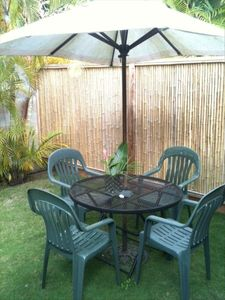 Outdoor sitting area with umbrella