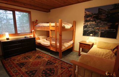 Downstairs bedroom 1. Twin bunk bed. Twin pull-out, 2 twin or king. Sleeps 4