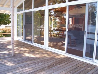 View of Wraparound Deck into Wall of Windows