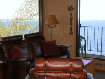 Living area with gas fireplace & walk out deck - Unit 1010.