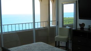 Luquillo condo photo - Sea Horse Balcony with floor to celing wall to wall glass doors.