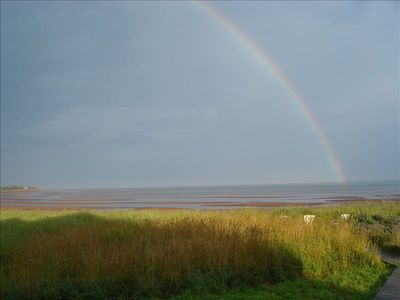 Rainbow over the tide coming in