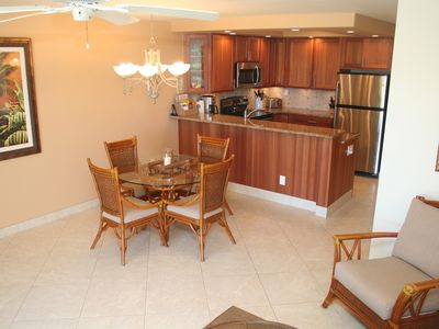 Deluxe kitchen with stainless appliances, granite counters, and tons of light.