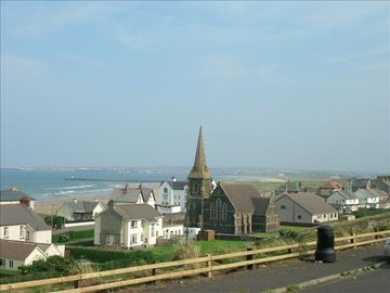 Castlerock from The Tunnel Brae with Portrush and Portstewart in background.
