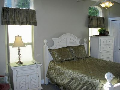 Master bedroom with private bath and open to covered porch.