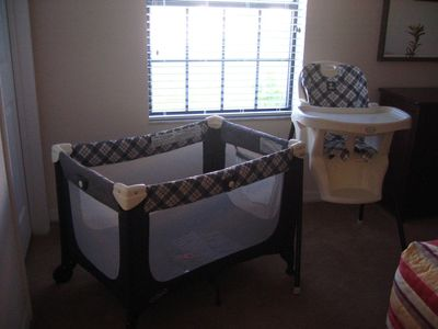 Cot and highchair for our little visitors