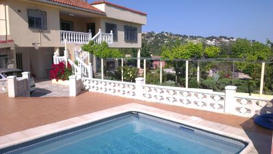 Godelleta villa rental - The view of the house, swimming pool, terrace and gardens