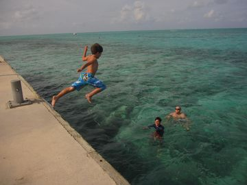 A jumping good time off the Rum Point Club pier...into the turquoise water.