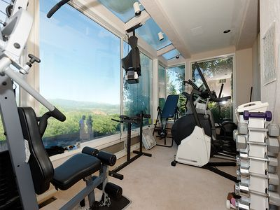 Gym includes 2 elipticals,treadmill,strength machine, TV, and panoramic views.