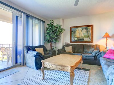 Our beautiful living room features ocean views - Sink into our comfy sofas and turn on the TV or simply sit back and let the ocean breezes wrap around you as you check out the ocean view.