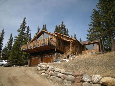 Gorgeous new square log sided home with sunny large deck.
