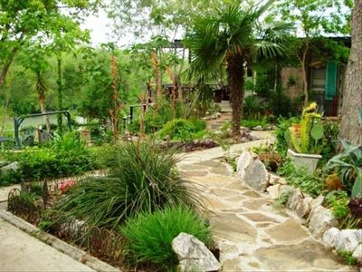 New Braunfels house rental - Wander garden paths toward the charming bunk house