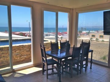 Dining Room table for 6 with Panoramic Ocean views and 3 slider doors to Jacuzzi