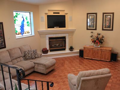 West Coast Villa Family Room with great seating, gas fireplace, flat screen TV
