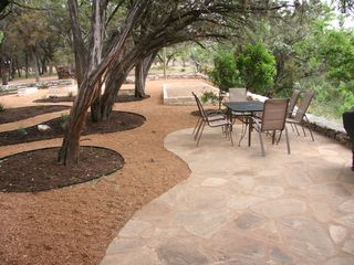 Flagstone patio, Weber grill and Bocce Ball Court. - Wimberley house vacation rental photo