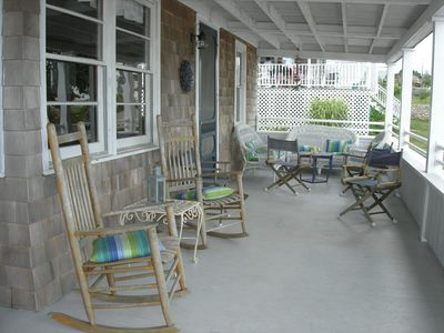 First floor porch offers a space to eat as well as to rock away your stress!