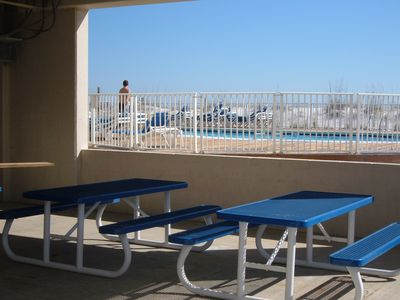 PICNIC TABLES ADJACENT TO BAR B Qs AND POOLS