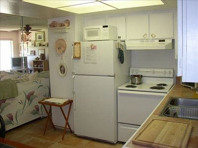 Fully equipped kitchen with cooking utensils, plates, silverware, etc.