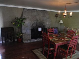 Lake Arrowhead cabin photo - After entering the front door, dining table and fireplace built in 1939.