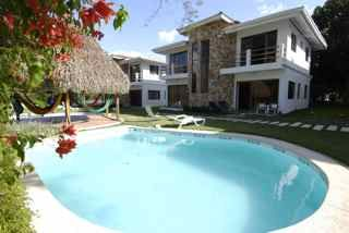 Playa Palmar townhome rental - View from the pool and front of the townhouse. Great windows very bright!