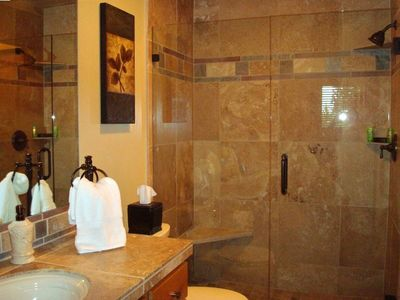 Travertine Bath with Beautifully Soft Absorbent Towels and Wash Cloths