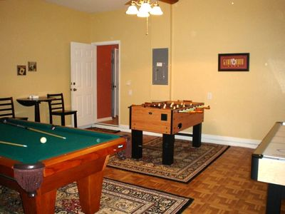Private Game Room with pool table, foosball, and air hockey