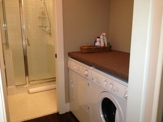 Savannah house photo - Laundry area with luggage rack counter