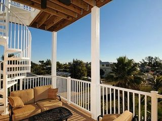 Anna Maria house photo - Large covered terrace leading to roof top deck.