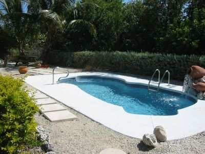 Pool area includes  Lounge chairs and picnic area . Easy access to wetbar