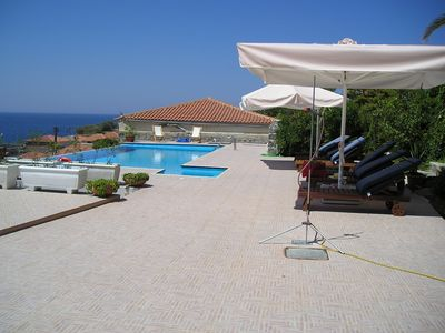 Villa Molova, spacious area with sunloungers and umbrellas near the pool
