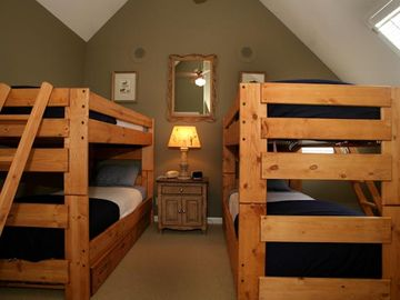 Upstairs bunk room with two bunks and two trundles sleeping six