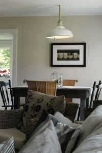 from living room you see the diningtable and funky farmhouse vintage light above