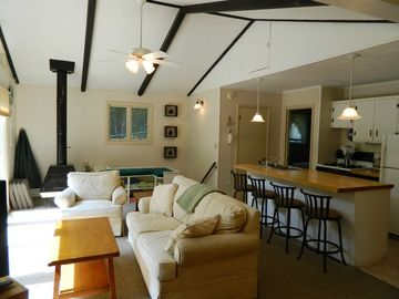 Living room with wood beams and comfy couch
