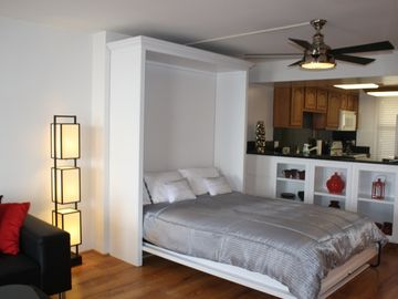 Queen Murphy Bed for extra guests concealed in a cabinet