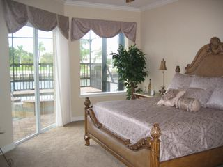 Vacation Homes in Marco Island house photo - Master suite with slider to lanai for easy jacuzzi access.