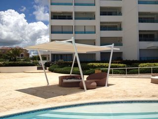 Juan Dolio condo photo - Shade areas located next to pool.