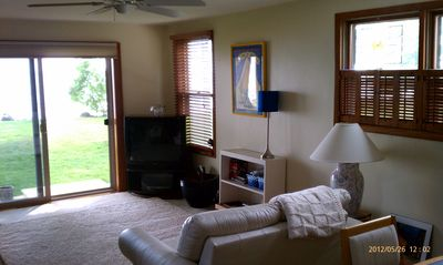 Lake Winnebago house rental - Sun tinted sliding glass door leading to the lake