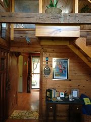 Breaux Bridge cottage photo - Bedroom loft is accessed by a staircase with railing.