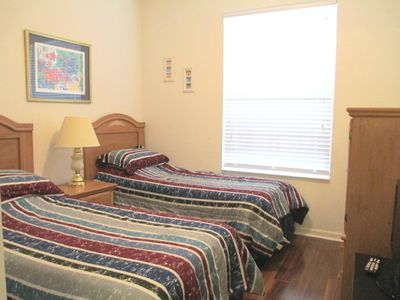 Kids room with 2 twin beds and LCD TV