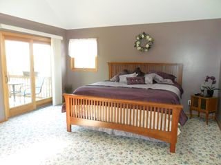 Brethren house photo - Upper level Master Suite, private patio overlooking deck and firepit
