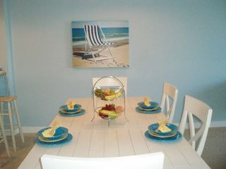 Vacation Homes in Ocean City condo photo - Dining table with ample bench & chair seating