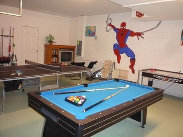 Games room with table tennis, pool and air hockey. Also TV for watching DVDs
