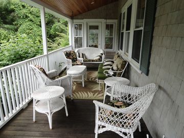 Covered porch with wicker furnishings.